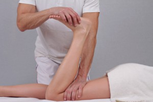 Chiropractic, osteopathy, sport massage concept. Therapist doing healing treatment on female leg